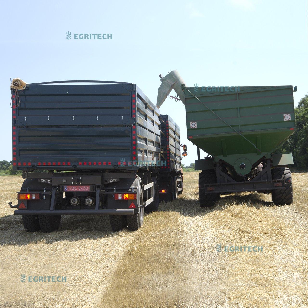 загрузка зерновоза бункером перегрузчиком